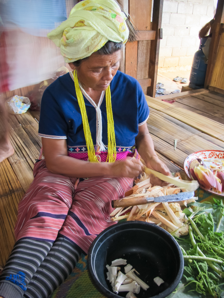 Mae Chaem district, Chiang Mai province, January 2013 Loh's mother prepares sits on the bamboo floor preparing vegetables for the evening's meal.