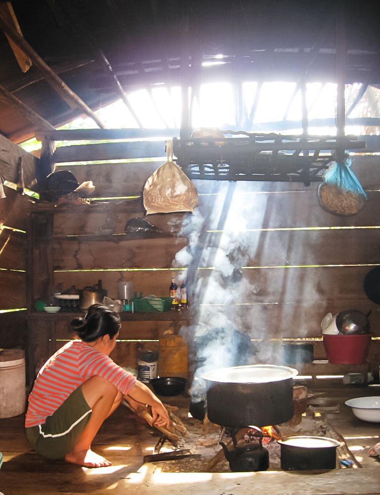 Mae Suai district, Chiang Rai province, December 2008 The cooking area is typically located inside a well-ventilated room attached to the family home.  The shelves suspended above the cooking fire and take advantage of the smoke and constant heat to preserve dried food products and next season's planting seeds stored.  During the cold season, family members gather around the fire to socialize and enjoy cups of bitter tea.